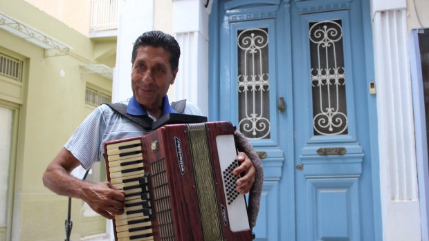 Local colour: A street musician adds to Nafplio's atmosphere.