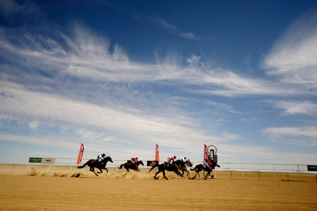 THE BIRDSVILLE RACES: It's fair to say that a day at the races in Birdsville involves a little less formality and ...