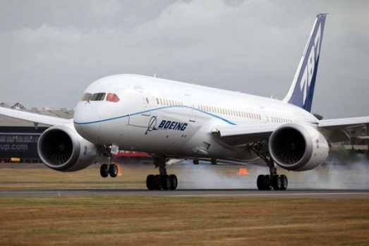 The Boeing 787 Dreamliner airplane lands prior to the opening of the Farnborough International Airshow.