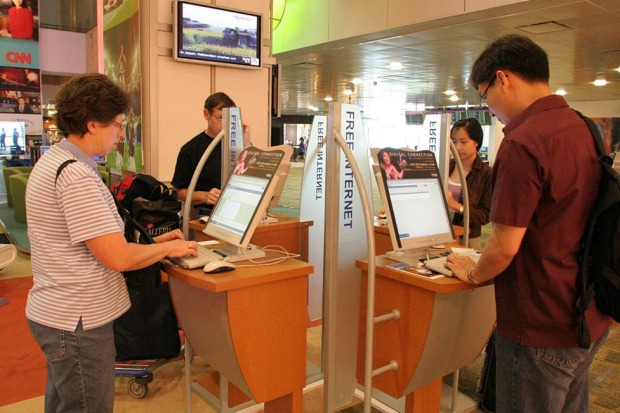 Travellers take advantage of the free internet kiosks.