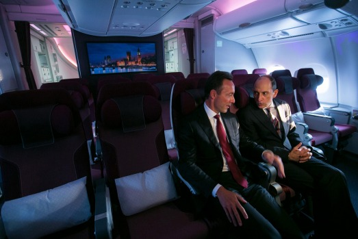 Fabrice Bregier, chief executive officer of Airbus, left, and Akbar Al Baker, chief executive officer of Qatar Airways, ...