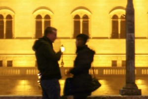 Silhouette of a couple in front of parliament building, Budapest, Hungary.