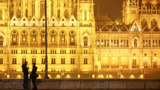 Romantic spot: A couple in front of parliament building, Budapest, Hungary.