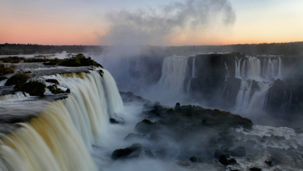 Niagara, eat your heart out: Sunset at the Iguazu Falls, Iguacu National Park, near the town of Foz do Iguacu, Parana, ...