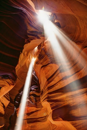 Just magical: Shafts of light streaming into Antelope Canyon, US.