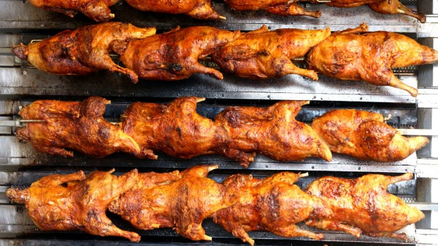 The most popular Bavarian dish, roasted chicken ('Bavarian Hendl') , ready for guests at Oktoberfest.