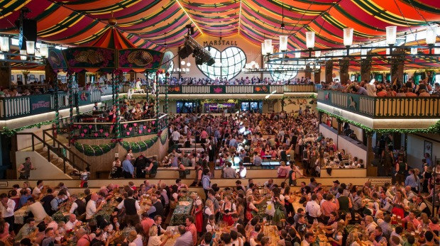 Visitors enjoy the brand-new festival beer tent 'Marstall' during the opening day of the 2014 Oktoberfest.