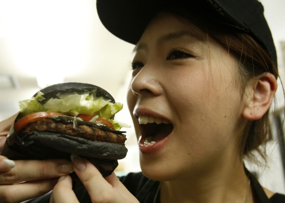 Black is the new burger: The buns are made from bamboo charcoal powder mixed in to give them a charred look, beef ...
