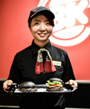 Burger King Japan customers have just two black burger options - the the Kuro Pearl, left, and the Kuro Diamond, right.
