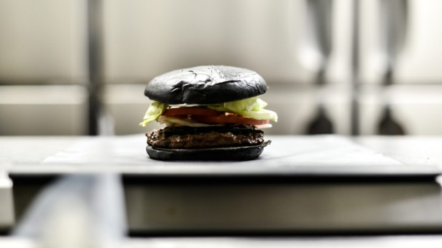 Like a whopper but black: The Kuro Diamond burger comes with cheese smoked with bamboo charcoal, black sauce made of ...