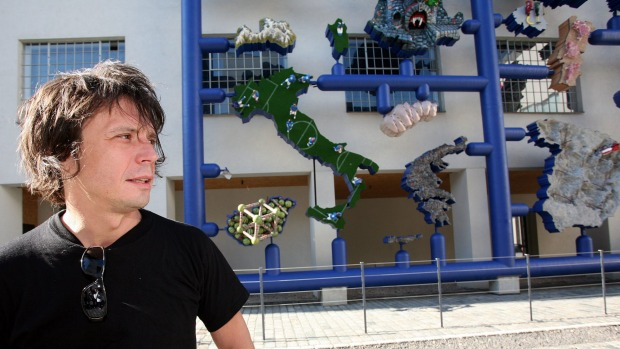 David Cerny in front of his work <em>Entropa</em>.