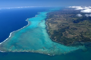 View from the top: Turquoise lagoon with saltwater channels and white sandy beach.