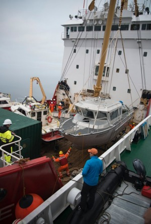 Vavilov to Coast Guard - Andrew Prossin, MD of One Ocean Expeditions supervises the transfer of search boats from the ...