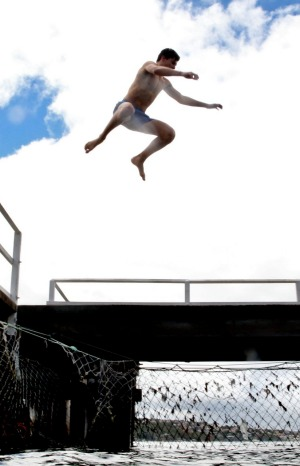 Safe landings: Jumping off the wharf at Chowder Bay.