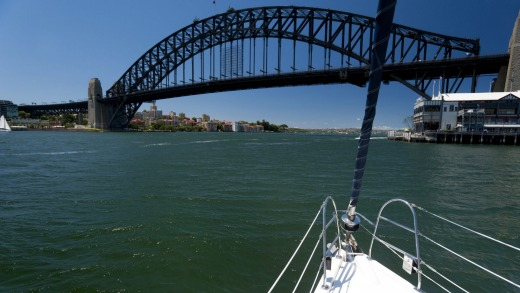 Sail away: Sydney Harbour Bridge from the bow of a yacht.