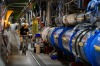 Europe's physics lab: A worker rides a bicycle in the tunnel of the European Organisation for Nuclear Research (CERN) in ...