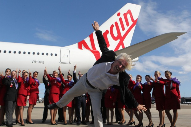 Contemporary twist: Virgin's 1960s-inspired uniform designed by Juli Grbac. Pictured, Richard Branson at Sydney Airport.