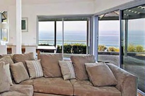 Window seat ... the Cliff's Edge living room has a comfy couch and a pillow-strewn day bed in a cosy corner.