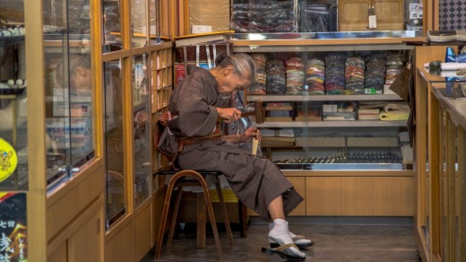 A woman works on traditional handicarfts in a store in Asakusa.