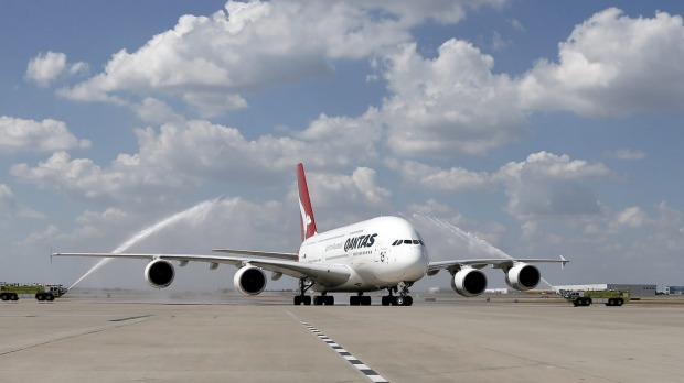 A Qantas A380 taxis to its gate during its inaugural landing at Dallas-Fort Worth International Airport in Texas after ...