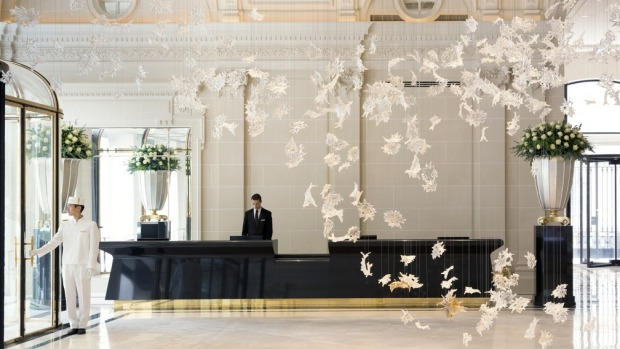 Exquisite: 800 Czech crystal leaves hang in the Peninsula Paris lobby.