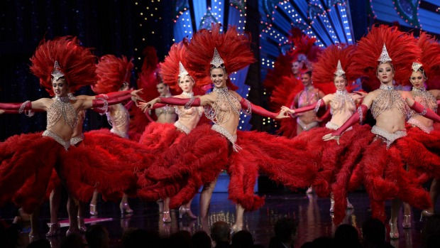 Dancers light the stage at the Moulin Rouge.