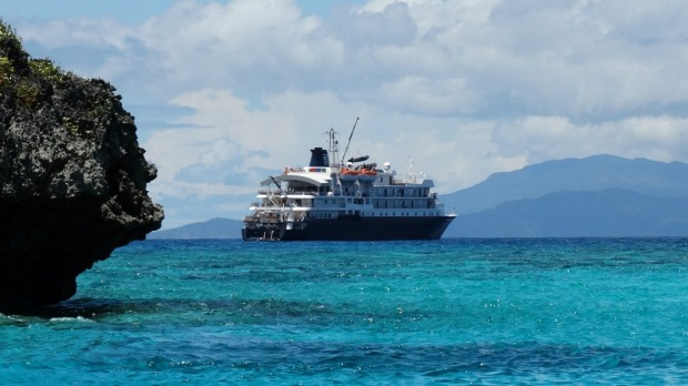 Luxury base: the Caledonian Sky, after a morning snorkelling among the atolls and coves of Pulau Wayag in West Papua.