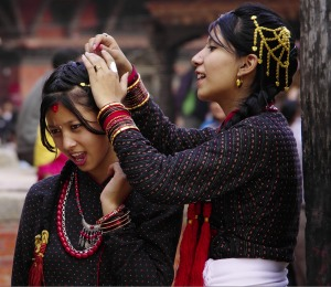 In the ancient Durbar Square of Patan in the Kathmandu valley we chanced upon a group in traditional finery preparing ...