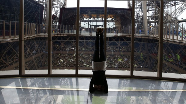 Visitors to the Eiffel Tower can walk or do yoga on a transparent floor at 188 feet high.