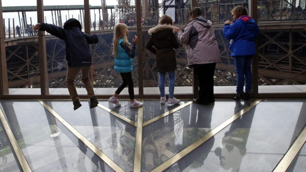 Visitors to the Eiffel Tower can walk on a transparent floor at 188 feet high.