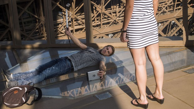 Taking a selfie on the new glass floor at the Eiffel Tower is the new must-do for tourists to Paris.