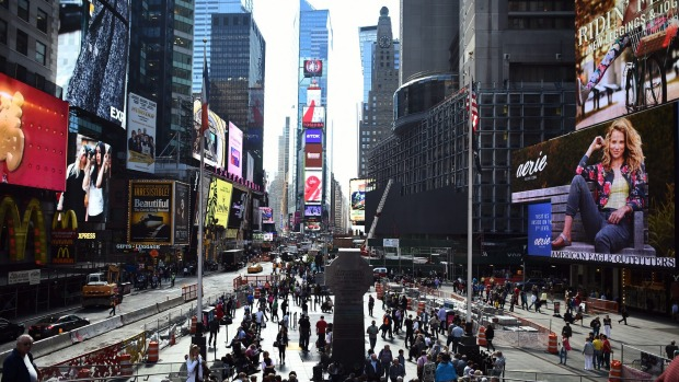 New York, USA: Tourists enjoy the atmosphere in Times Square.