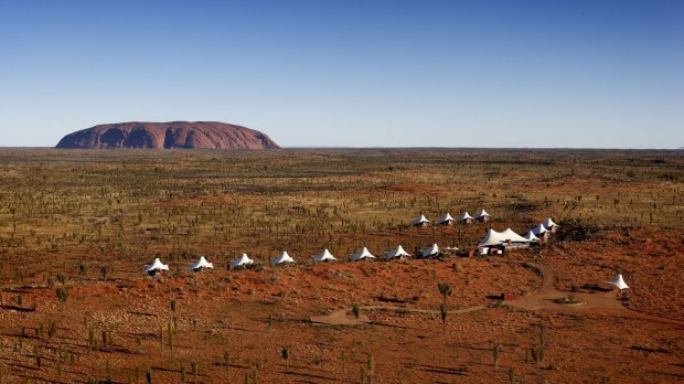 An aerial view of Longitude 131, the luxury lodge with Uluru as its backdrop.