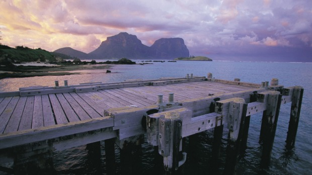 Tranquil beauty: View of the jetty with Mount Gower and Mount Lidgbird in the distance.