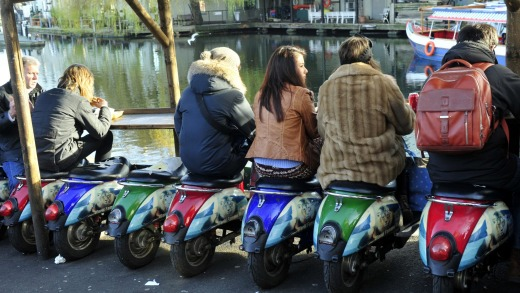 Hot seat: Scooters offer alfresco dining at Camden market.