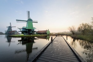 Typical scene: Traditional Dutch windmills at the Zaanse Schans in The Netherlands, seen from a yetty.