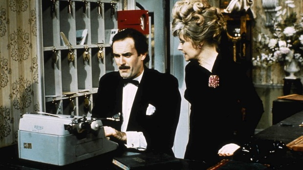 Fawlty reception: Basil and Sybil  at the front desk.