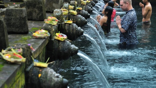 Healing waters: A visitor joins the Balinese at the Pura Tirta Empul.