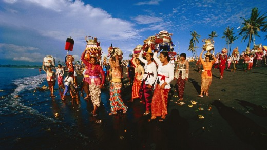 All together: Villagers take part in a ceremony in Bali.