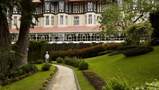 Colonial remains: The gardens of the English-style Grand Hotel at Nuwara, Eliya are a manicured delight.