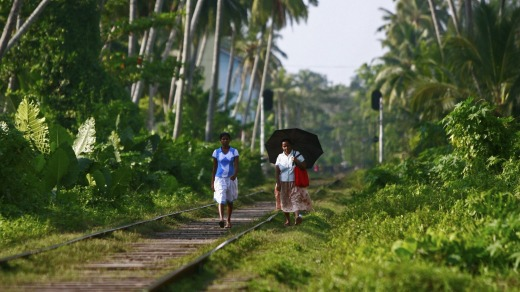 Short cut: Villagers use the rail tracks as pathways.