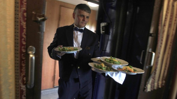 Lunch is served aboard a historic Tehran-bound train as it leaves Budapest.