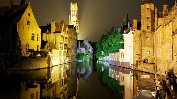 Wonderfully atmospheric: The historic canal district of, Bruges, Belgium, after dark.