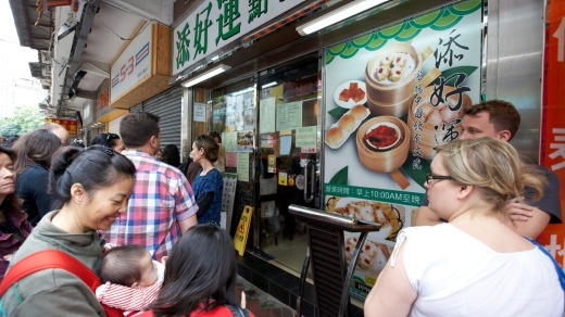 Cue the taste: Queuing outside tim Ho Wan restaurant in Kowloon, Hong Kong.