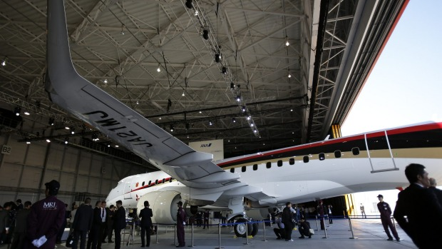 The MRJ stands in a hangar.