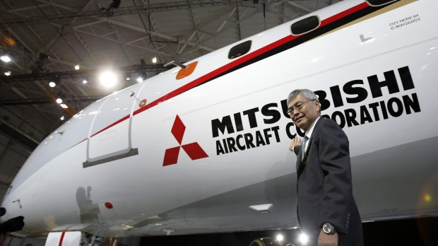 Hideaki Omiya, chairman of Mitsubishi Heavy Industries Ltd, poses for a photograph in front of the Mitsubishi Regional ...