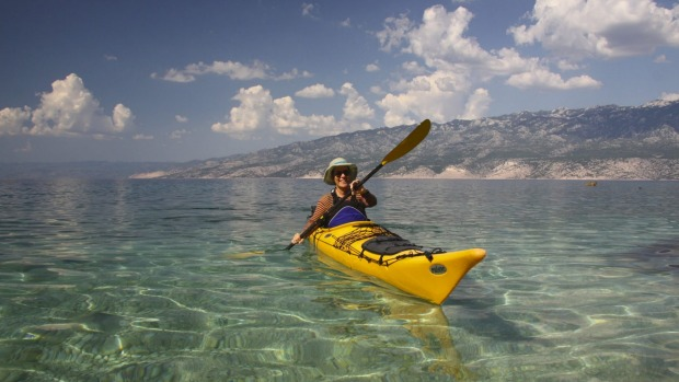 Paddling in to a beach for a swim, the Velebit mountains in the background
