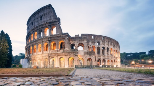 Landmark: The Colosseum in Rome at sunrise.