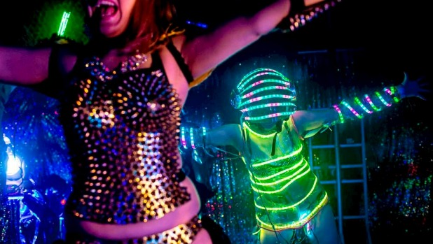 Dancers dressed as futuristic characters perform during a show at The Robot Restaurant  in Tokyo, Japan.