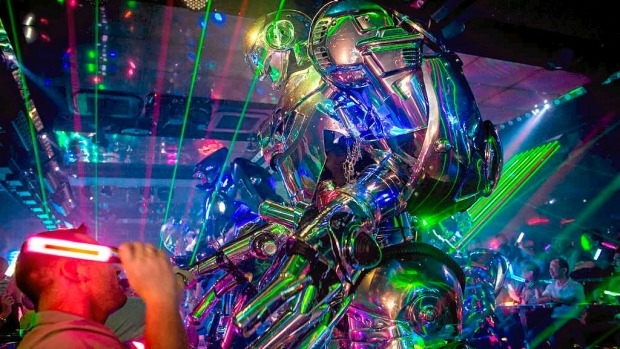 Customers watch on as a large scale robot performs during a show at The Robot Restaurant in Tokyo, Japan.